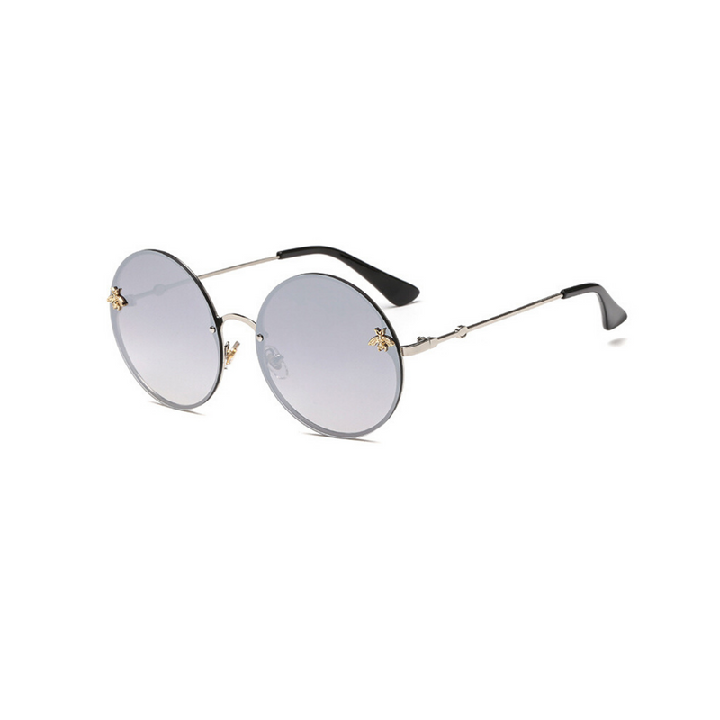 Side view of silver, large circle sunglasses, with mirror lenses and bee detail on the lenses.