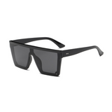Side view of black, square block sunglasses, with dark lenses.