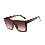 Side view of leopard, square block sunglasses, with brown gradient lenses.