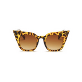Front view of leopard, super cat eye sunglasses, with brown lenses.