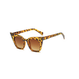 Side view of leopard, super cat eye sunglasses, with brown lenses.