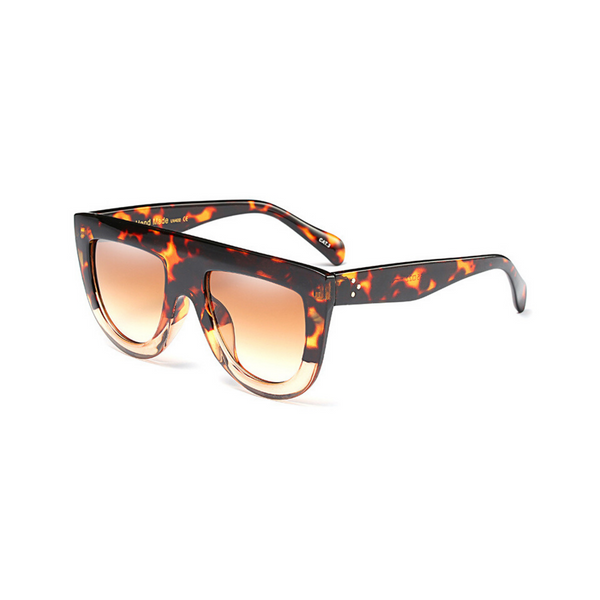Side view of leopard and clear, flat top oversized sunglasses, with brown tinted lenses.