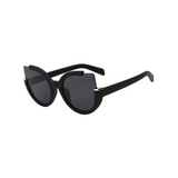 Side view of black, large cat eye sunglasses, with dark lenses.