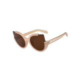 Side view of brown, large cat eye sunglasses, with dark lenses.