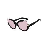Side view of pink, large cat eye sunglasses, with mirror lenses.