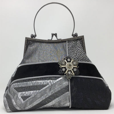 Geometric Silver Metallic Handbag with Black Suede