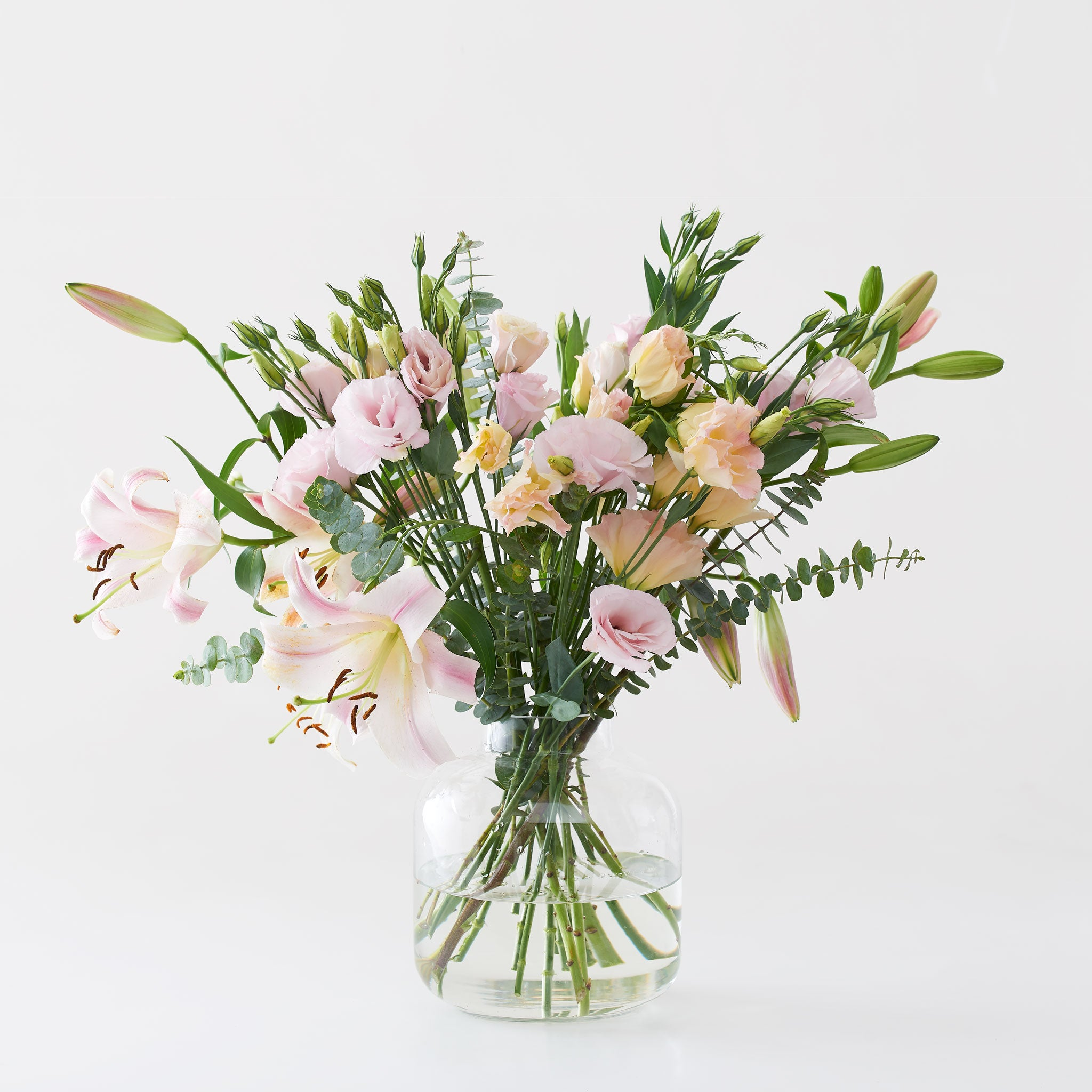 Photo of our Somewhere Only We Know flower arrangement in a vase including the lily, lisianthus and designer pennygum. Julep offers flower delivery Johannesburg and flowers in a box.