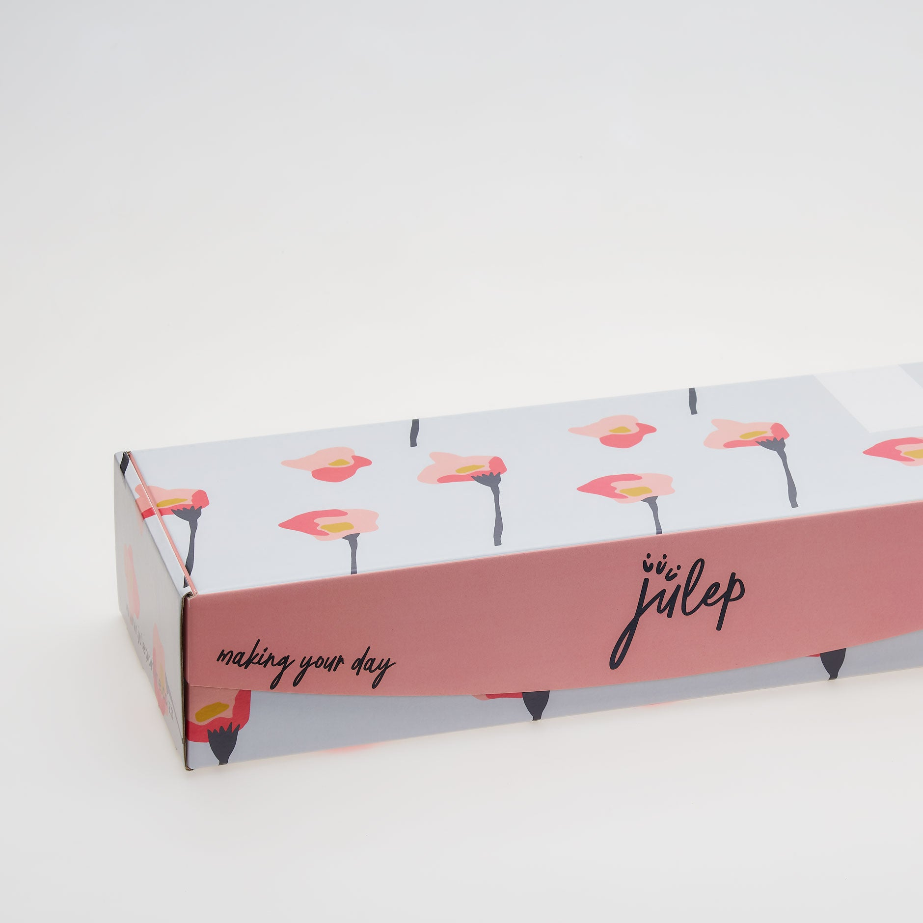 Photo of our Julep box. Flowers are delivered in a long cardboard box.