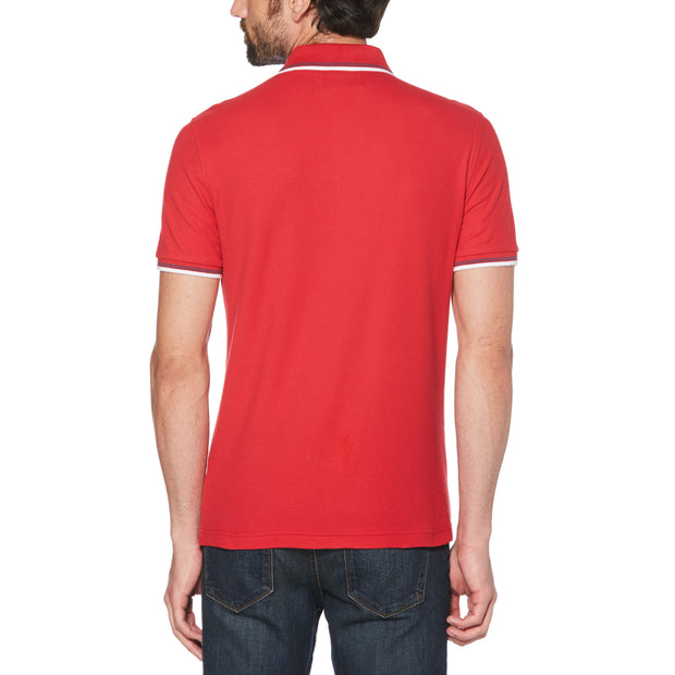 STICKER PETE PIQUE POLO SHIRT IN LIPSTICK RED