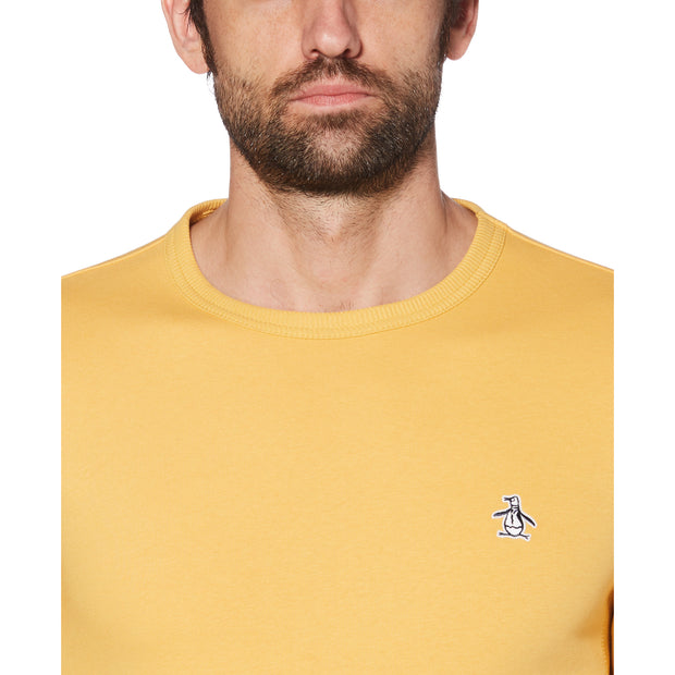 STICKER PETE FLEECE SWEATSHIRT IN HONEY GOLD