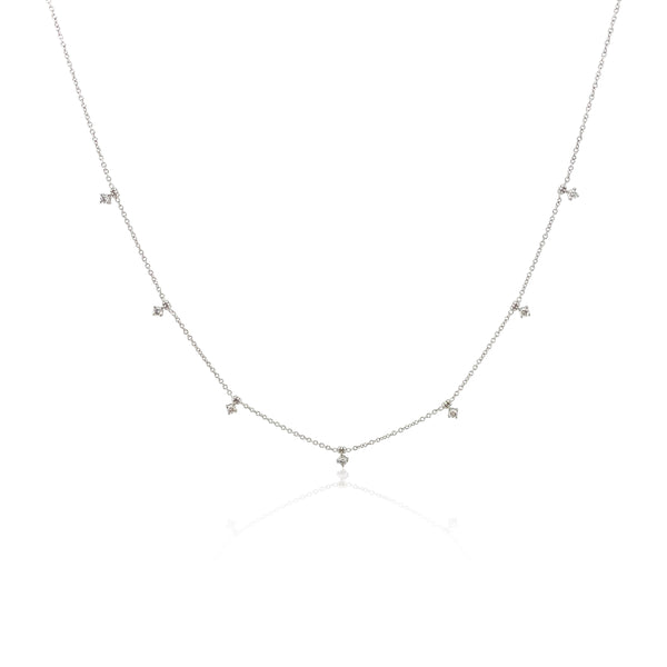 San Antonio Jewelry, quarter carat stackable dainty diamond necklace; 7 total round diamonds spaced an inch apart evenly; adjustable slide clasp chain