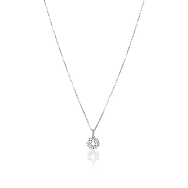 San Antonio Jewelry baguette diamond pendant with round diamond accents in 18k white gold.