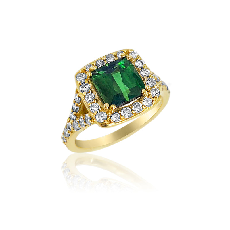 San Antonio Jewelry green tourmaline and diamond ring in yellow gold.