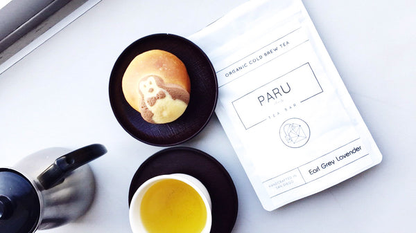 Paru Tea Bar packaging with a teacup, tea and latte with a penguin pastry