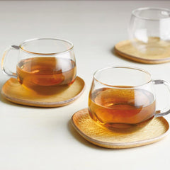 Tea glasses on wooden plates