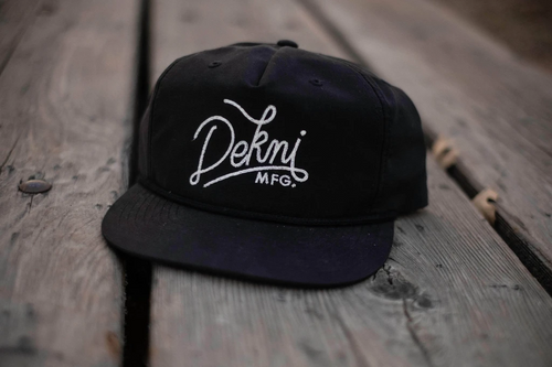 PINCH FRONT - NYLON - BLACK CUSTOM SNAPBACK WITH FLAT EMBROIDERY BY DEKNI CREATIONS IN BULK CAPS