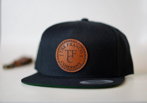 custom designed hat with leather patch