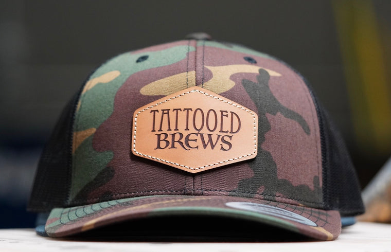camo hat with leather patch
