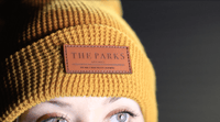 yellow custom knit beanie with leather patch engraved by dekni creations