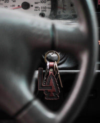 Custom Laser Engraved Leather Keychain Behind Steering Wheel by Dekni Creations