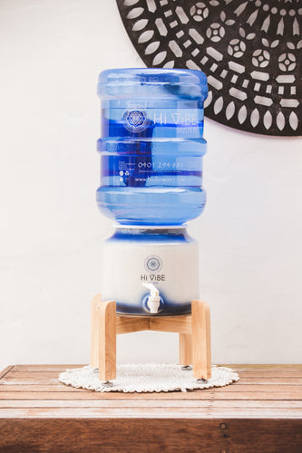 Beautiful Timber Stand with hi vibe ceramic and water bottle on top.