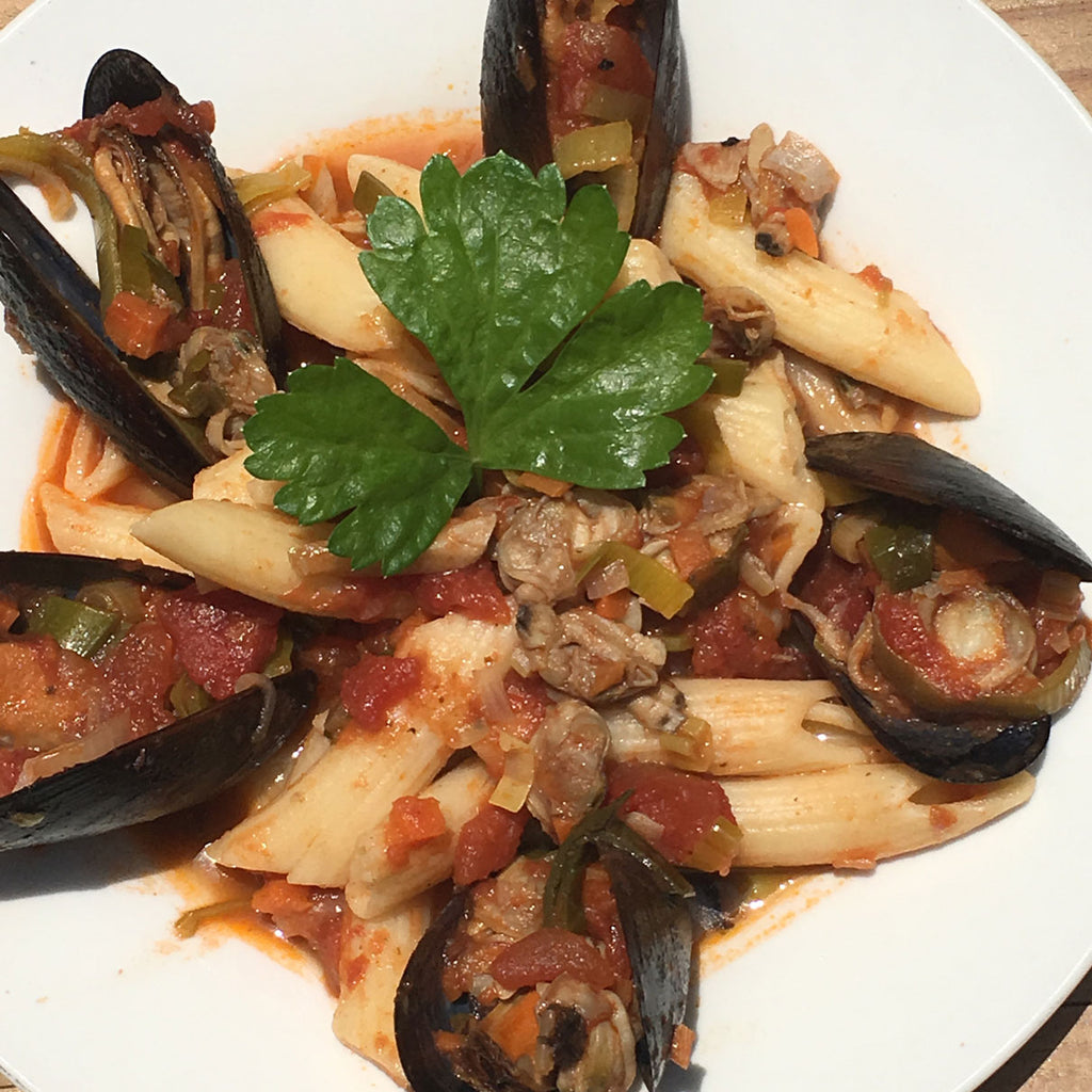 Gluten Free Penne Rigate with Mussels in Tomato and Red wine sauce.