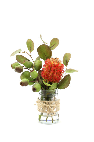 Simple Australian Native Flowers including Banksia, Gumnuts and Eucalptus leaves in a Mason jar