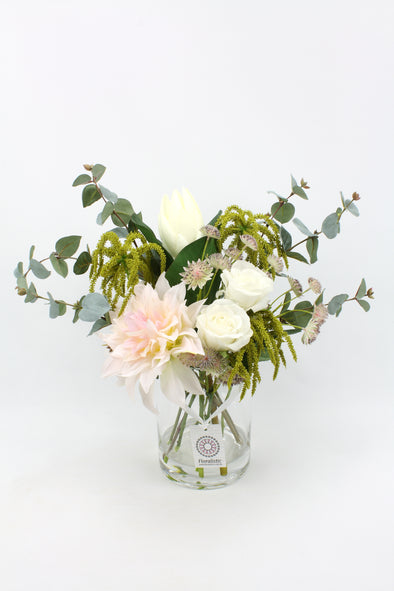 pink and white artificial flower arrangement in resin