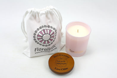 Scented natural soy candle in frosted pink vessel with personalised wooden lid