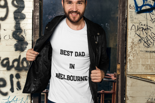 Man holding his black jacket open to reveal a White TShirt with Best Dad In Melbourne Fathers Day TShirt-Design & Personalise your own Shirts by clicking on the link in the description