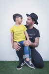 Man with a child sitting on his knee wearing a Black fathers day tshirt with Clones design on front of shirt-Personalise and design your own custom shirt by clicking in the link in the description