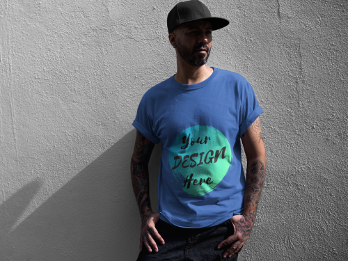 Man wearing a Blue T-Shirt with Your Design Here on the front. Personalise with your own designs online free