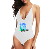 Woman wearing a White Custom Logo Swimsuit featuring our INKCru & Co Logo on the front-Personalised Swimwear can be design using the Custom Swimwear Maker Tool