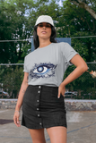 Woman wearing a Grey T-Shirt with a Floral Eye Design in Blue and White on the Front of the shirt-Personalise your own Custom T-Shirts by clicking on the link in the description