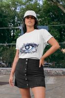Woman wearing a White T-Shirt with a Floral Eye Design in Blue and White on the Front of the shirt-Personalise your own Custom T-Shirts by clicking on the link in the description