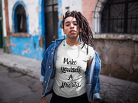 Woman wearing a White Custom TShirt with Make yourself a priority slogan on the front in Black Writing-Personalise your own custom shirt by clicking on the link in the description