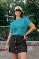 Woman wearing a Sea Green Custom Shirt featuring an Artist Humpback Whale Sketch on the front-Personalise your own Custom TShirt by clicking on the link in the description