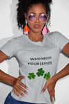 Woman wearing a Grey TShirt with the slogan, Who Needs Four Leaves on the Front of the TShirt , and Three Leaved Clovers in Green underneath the Slogan-Personalise your own Custom TShirt Free by clicking in the link in the description