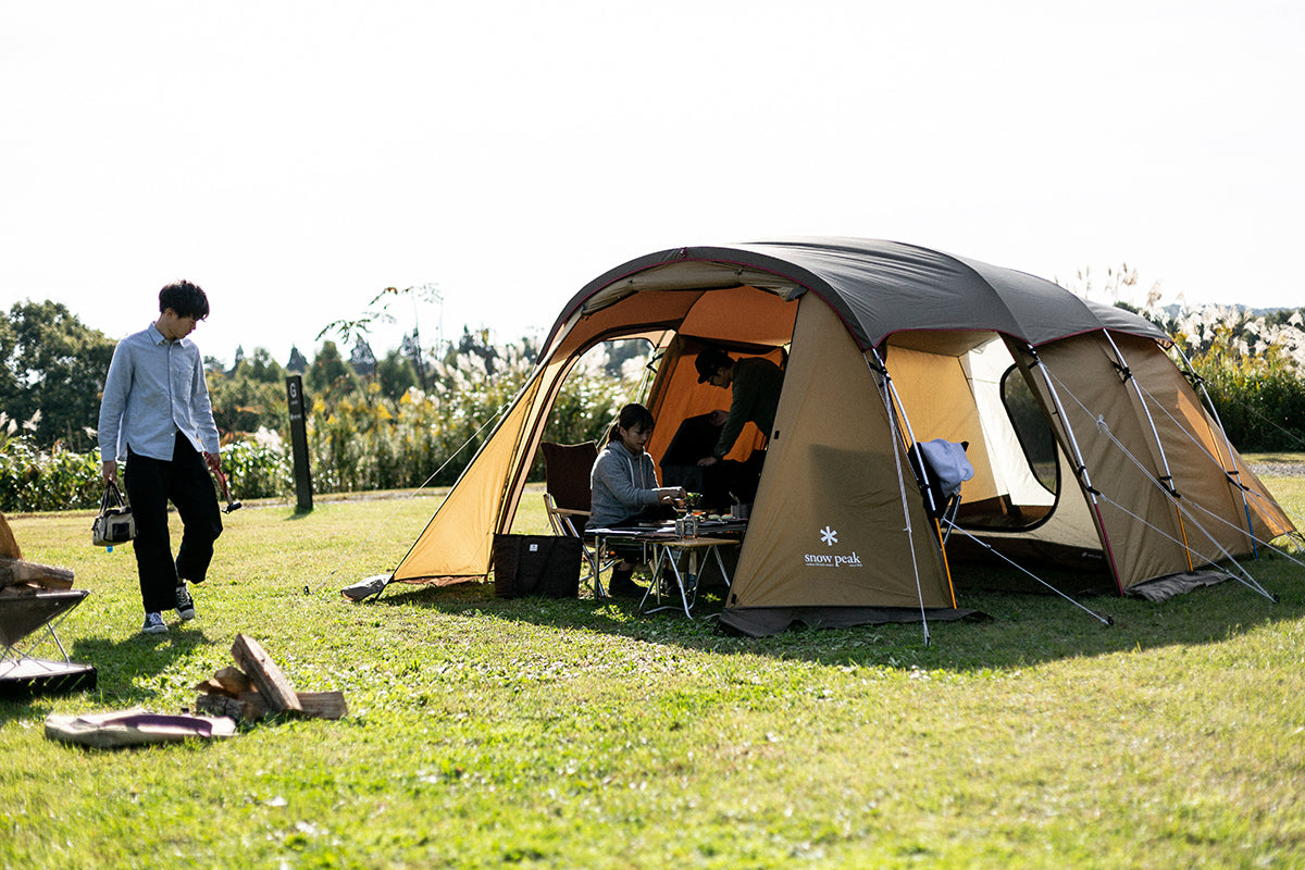 snow peak high quality large 2 rooms shelter tent entry 2 room elfield in a camping filed with three campers