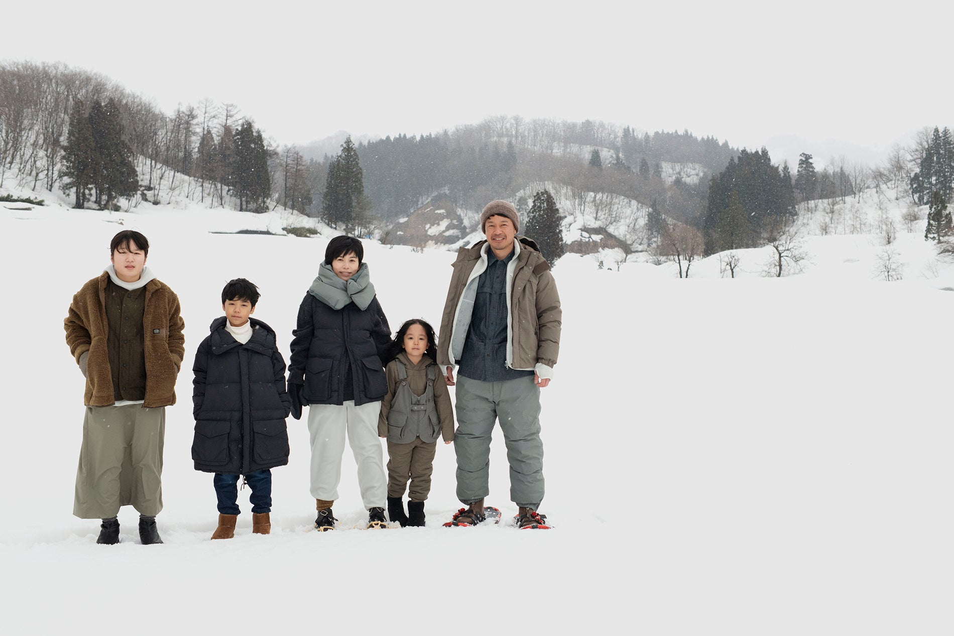 Snow Peak Apparel AW21 look book Japanese model family in the snow field