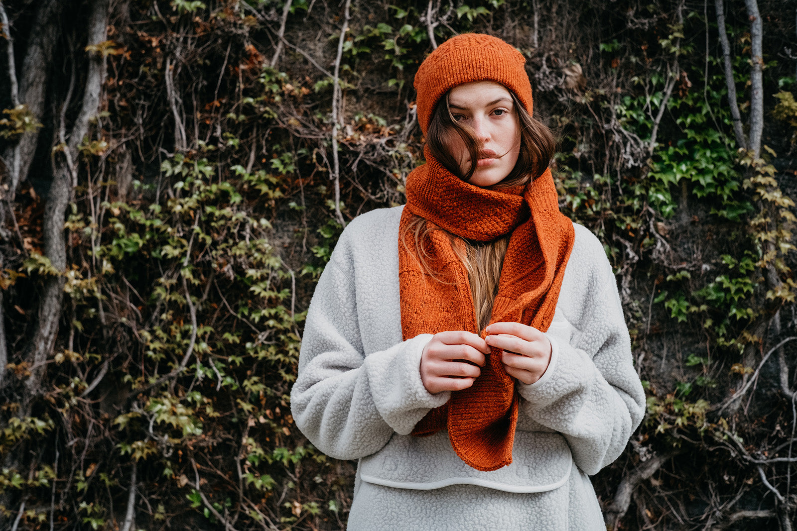 A British female model wearing Snow Peak Apparel AW21 Thermal fleece pullover and alpaca knit hat and scarf