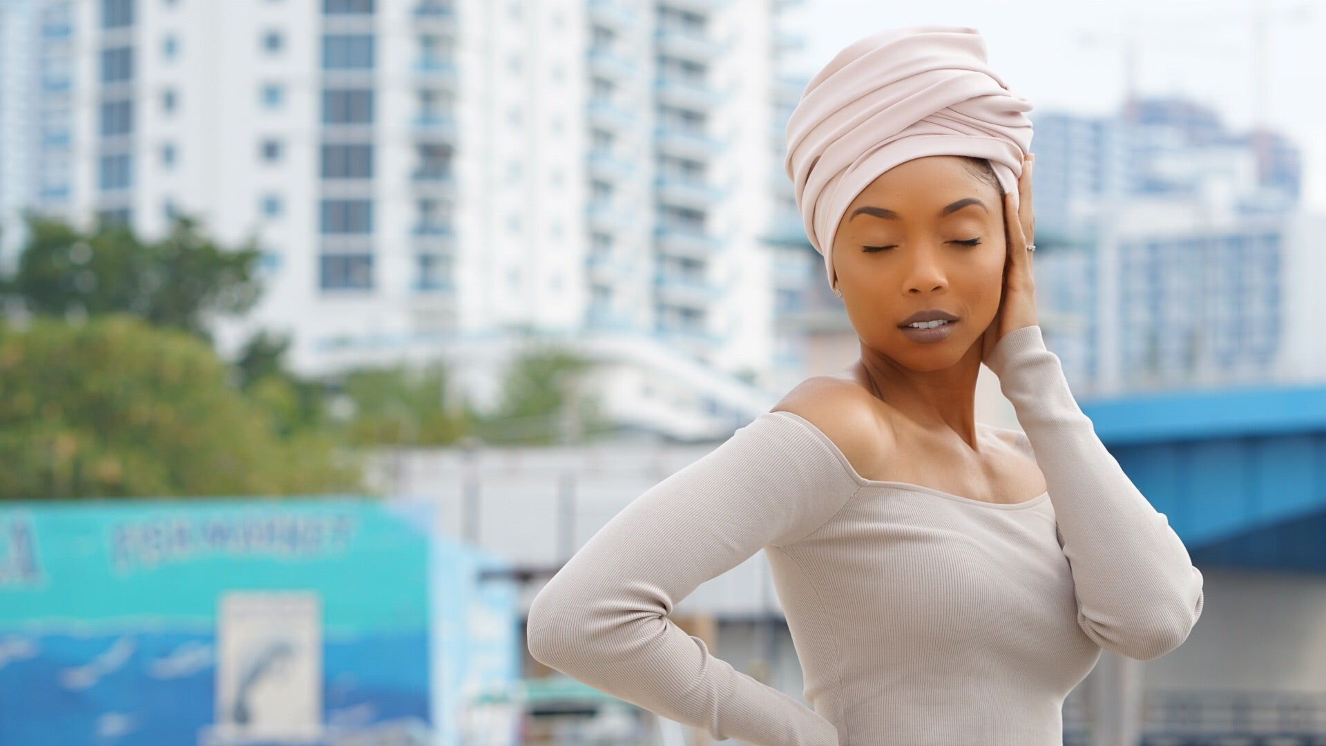 woman with blush colored head wrap