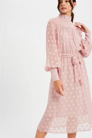 This LE LD0703 cocktail dress in mauve features a high neckline, a polka dot sheer pattern, and buttons on the cuffs.