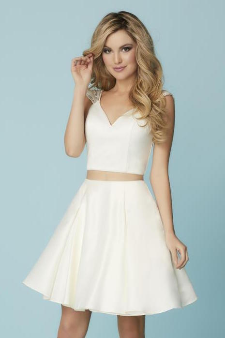This white two-piece Hannah S 27192 dress has beaded cap-sleeves.