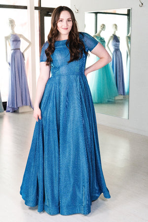 This MJS 19-262M A-line gown in royal features cap sleeves and a high neckline.