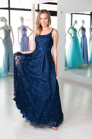 This. DJ A9361 simple lace gown in navy features a straight neckline and an open back.
