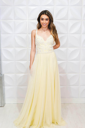 This Sherri Hill 53556 gown in yellow/ivory features a beaded bodice with a sweetheart neckline.