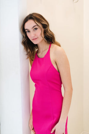 This SUG SD1826 fitted cocktail dress in pink features a high halter neckline and a unique strapped back.