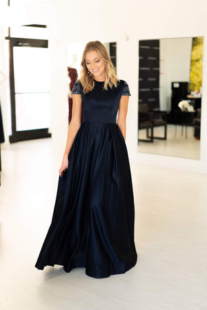 This Mac Duggal 25947 A-line gown in navy features a modest cap sleeve with a high neckline and back.