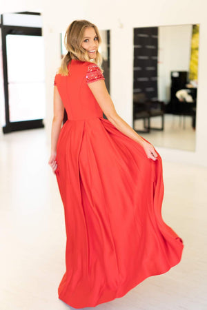 This Mac Duggal 25947 A-line gown in red features a modest cap sleeve with a high neckline and back.